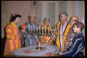 Hanukkah Four generation of Jews from central Asia light the candles